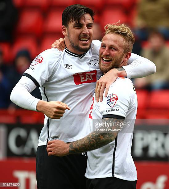 Derby's Johnny Russell celebrates with team mates George Thorne after he scores the first goal of the game during the Sky Bet Championship match...