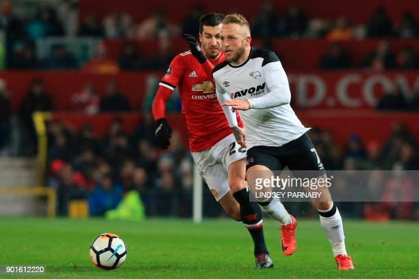 Derby's Scottish striker Johnny Russell takes on Manchester United's Armenian midfielder Henrikh Mkhitaryan during the English FA Cup third round...