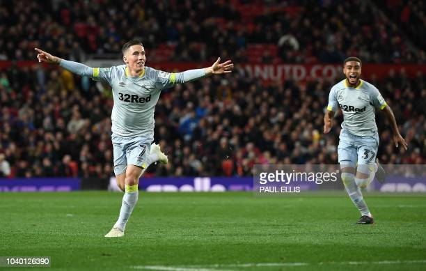 Derby's Welsh midfielder Harry Wilson celebrates scoring his team's first goal during the English League Cup third round football match between...