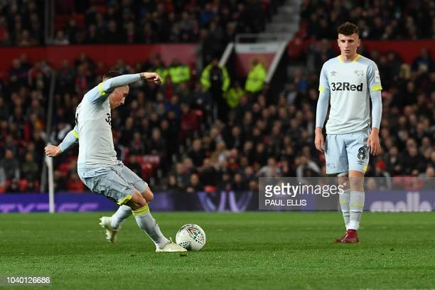 Derby's Welsh midfielder Harry Wilson takes a free kick to score his team's first goal during the English League Cup third round football match...