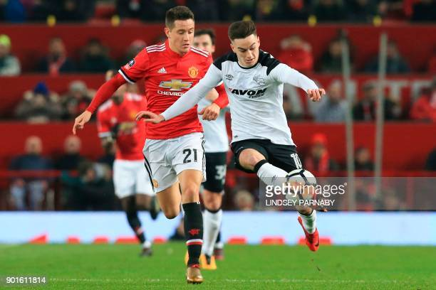 Derby's Welsh midfielder Tom Lawrence tries to hold off Manchester United's Spanish midfielder Ander Herrera during the English FA Cup third round...
