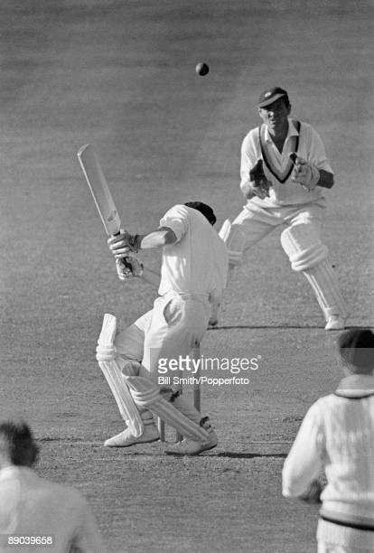 Derbyshire batsman DHK Smith ducks a bouncer from Yorkshire's Richard Hutton at Derby, circa 1969. The Yorkshire wicketkeeper is Jimmy Binks.