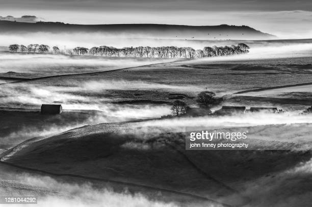 derbyshire rolling hills with mist and fog at sunrise. - weather stock pictures, royalty-free photos & images