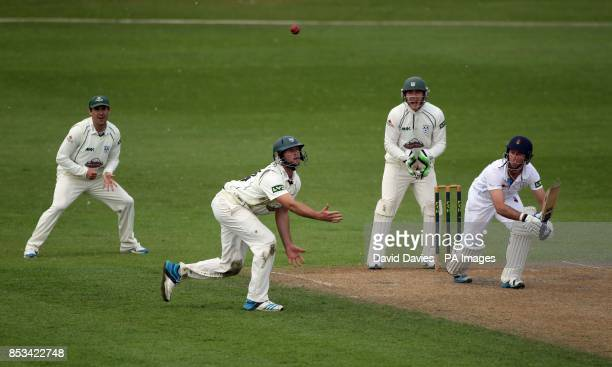 Derbyshire's Wayne Madsen chips the ball over Worcestershire's Ross Whiteley during day two of the LV= County Championship Division Two match at New...