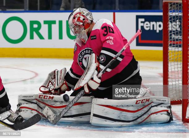 Dereck Baribeau of the Quebec Remparts makes a save against the Sherbrooke Phoenix during the third period of their QMJHL hockey game at the Centre...