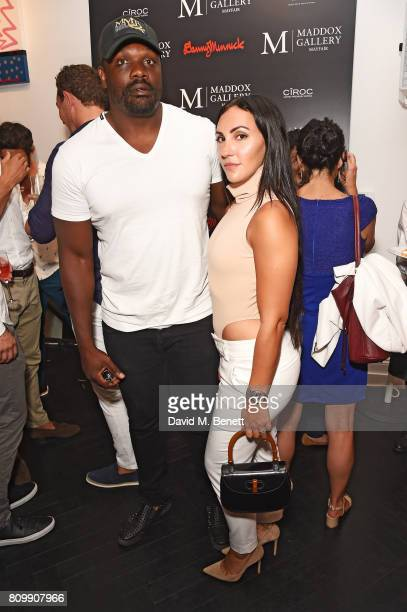 Dereck Chisora and guest attend a private view of 'One Love' the first UK solo exhibition from LA artist Danny Minnick at Maddox Gallery in...