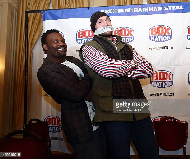 Dereck Chisora and Tyson Fury go headtohead during the Dereck Chisora And Tyson Fury Press Conference at The Grosvenor House on September 22 2014 in...