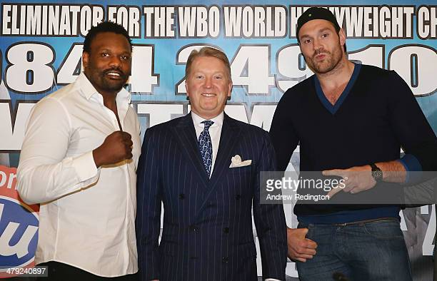 Dereck Chisora and Tyson Fury pose with promoter Frank Warren during a press conference to announce a final eliminator for the WBO world heavyweight...