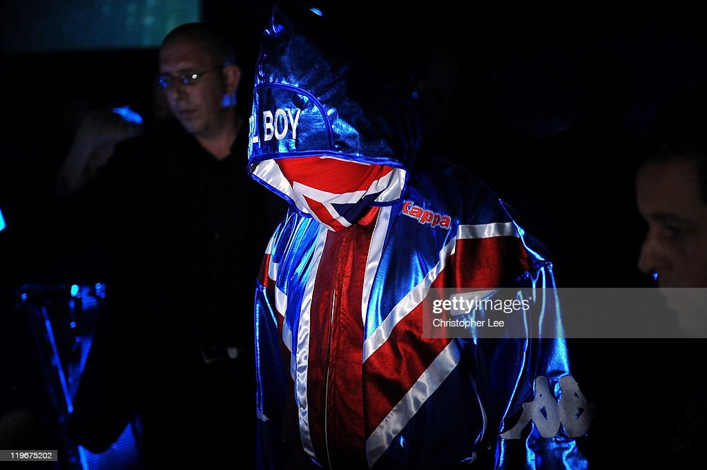 Dereck Chisora enters the ring wearing a Union Flag gown and a Union Flag scarf during the British & Commonwealth Heavyweight Title Fight between Dereck Chisora and Tyson Fury at Wembley Arena on July 23, 2011 in London, England.