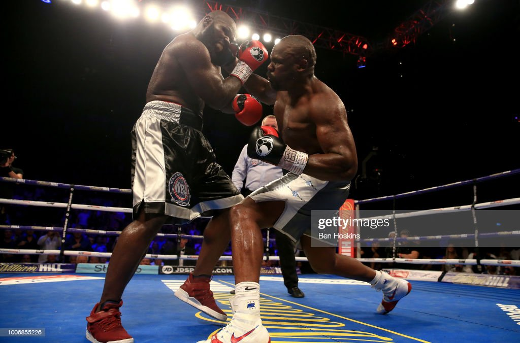 Dereck Chisora knocks down Carlos Takam during the Heavyweight fight between Dereck Chisora and Carlos Takam at The O2 Arena on July 28, 2018 in London, England.