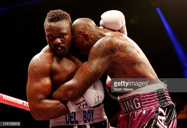 Dereck Chisora of England in action with Malik Scott of USA during their Vacant WBO International Heavyweight Championship bout at Wembley Arena on...