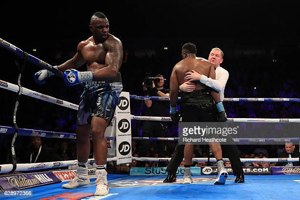 Dereck Chisora of Finchley is held by the Referee during his WBC World Heavyweight Title Eliminator WBC International Championship fight against...