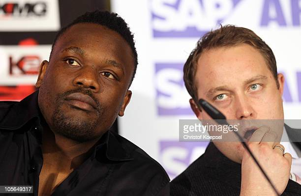 Dereck Chisora of GreatBritain and his promoter Frank Warren look thoughtful during the press conference at the SAP Arena on October 18 2010 in...