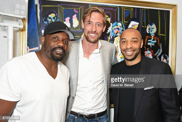 Dereck Chisora Peter Crouch and Thierry Henry attend a VIP private view for New York artist Bradley Theodore at Maddox Gallery on April 19 2017 in...