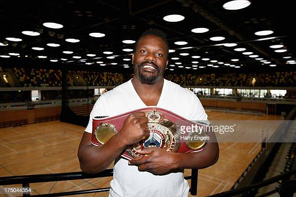 Dereck Chisora poses with his WBO International Heavyweight Championship belt prior to a press conference organised by boxing promoter Frank Warren...
