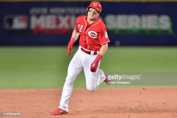 Dereck Dietrich outfielder of the Cincinnati Reds connects a hit and runs to third base on the ninth inning of the game between the Cincinnati Reds...