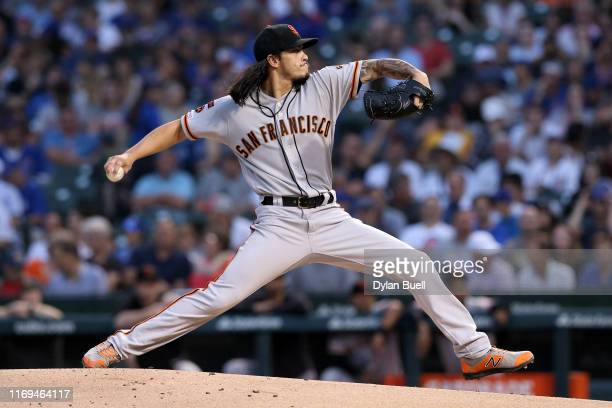 Dereck Rodriguez of the San Francisco Giants pitches in the first inning against the Chicago Cubs at Wrigley Field on August 21 2019 in Chicago...
