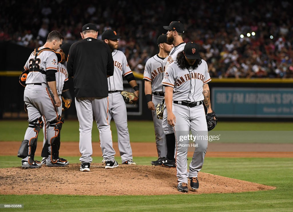Dereck Rodriguez #57 of the San Francisco Giants walks back to the dugout after being relieved during the seventh inning against the Arizona Diamondbacks at Chase Field on June 30, 2018 in Phoenix, Arizona.