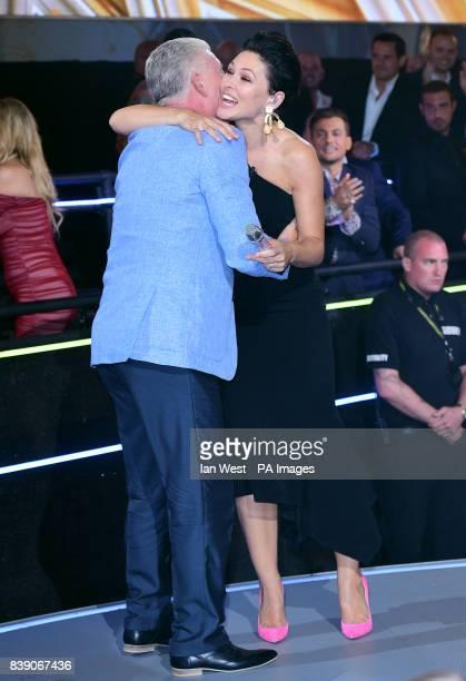 Derek Acorah hugs host Emma Willis during the live final of Celebrity Big Brother at Elstree Studios in Borehamwood Hertfordshire