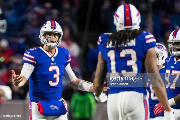 Derek Anderson discusses the previous play with Kelvin Benjamin of the Buffalo Bills his intended target on a pass play during the fourth quarter...