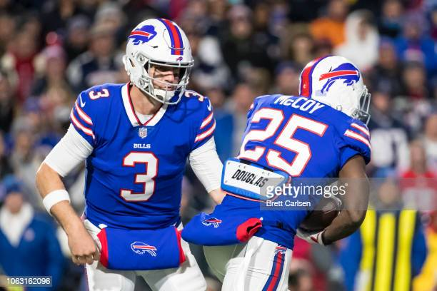Derek Anderson of the Buffalo Bills hands the ball to LeSean McCoy during the first quarter against the New England Patriots at New Era Field on...