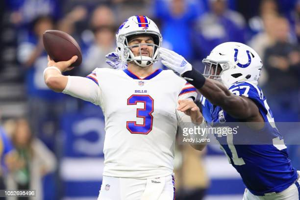 Derek Anderson of the Buffalo Bills is hit while throwing a pass by Kemoko Turay of the Indianapolis Colts in the first quarter at Lucas Oil Stadium...