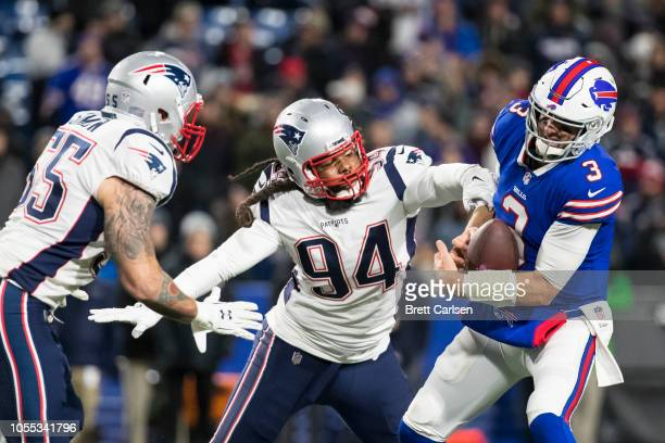Derek Anderson of the Buffalo Bills is sacked by Adrian Clayborn and John Simon of the New England Patriots during the fourth quarter at New Era...
