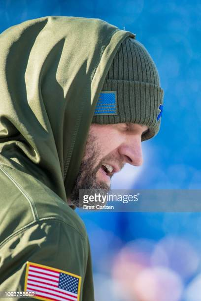 Derek Anderson of the Buffalo Bills speaks with a trainer before the game against the Chicago Bears at New Era Field on November 4 2018 in Orchard...
