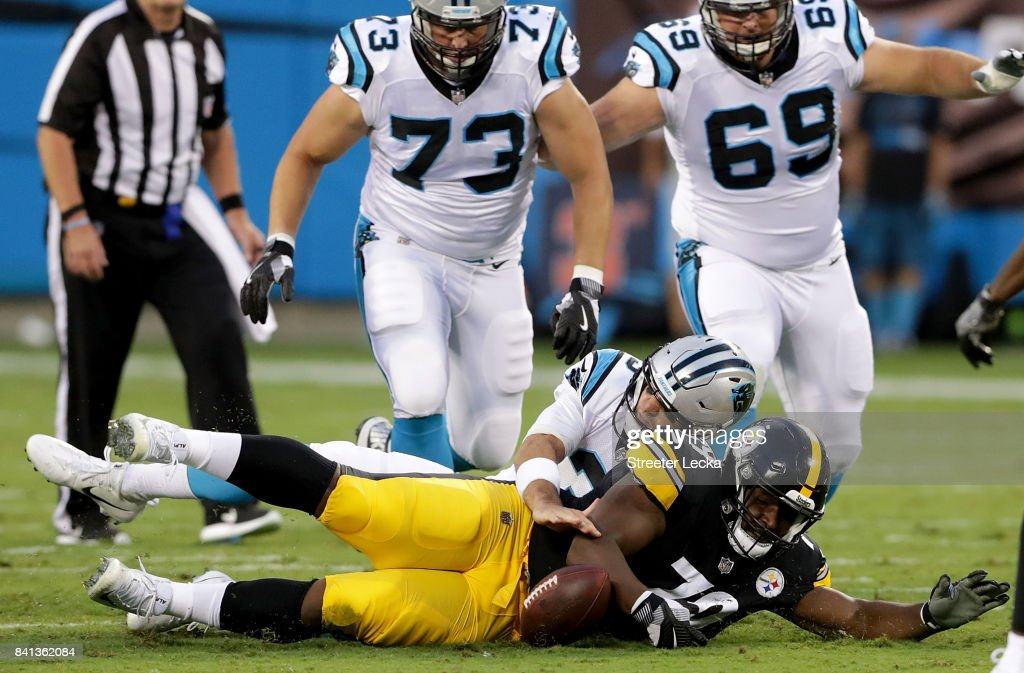 Derek Anderson #3 of the Carolina Panthers and Javon Hargrave #79 of the Pittsburgh Steelers go after a loose ball during their game at Bank of America Stadium on August 31, 2017 in Charlotte, North Carolina.