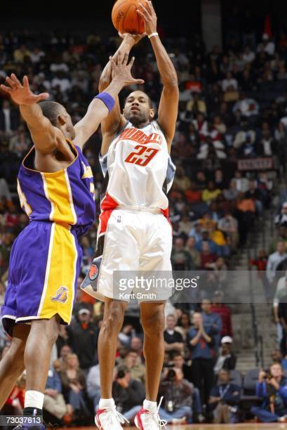 Derek Anderson of the Charlotte Bobcats shoots over Kobe Bryant of the Los Angeles Lakers during the game at Charlotte Bobcats Arena on December 29...