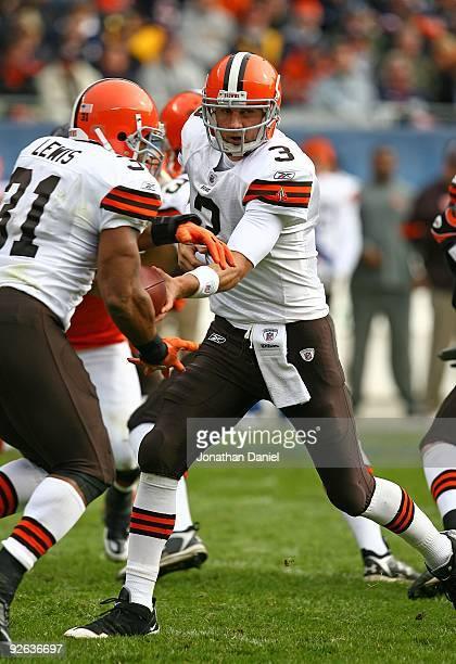 Derek Anderson of the Cleveland Browns handsoff to Jamal Lewis against the Chicago Bears at Soldier Field on November 1 2009 in Chicago Illinois The...