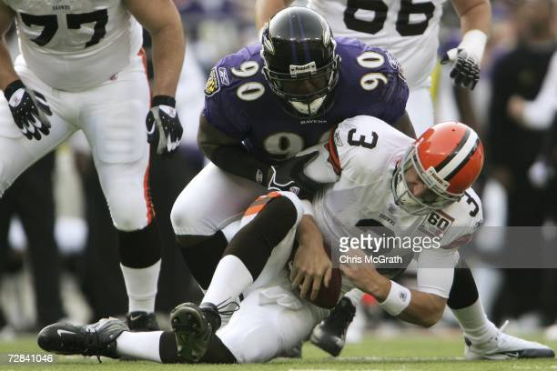 Derek Anderson of the Cleveland Browns is sacked by Trevor Pryce of the Baltimore Ravens at M&T Bank Stadium December 17, 2006 in Baltimore, Maryland.