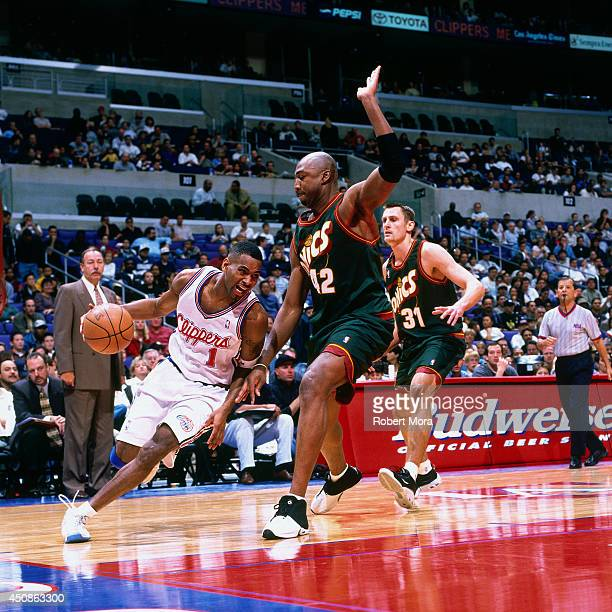Derek Anderson of the Los Angeles Clippers drives to the basket against Vin Baker of the Seattle Supersonics on December 12 2000 at Staples Center in...