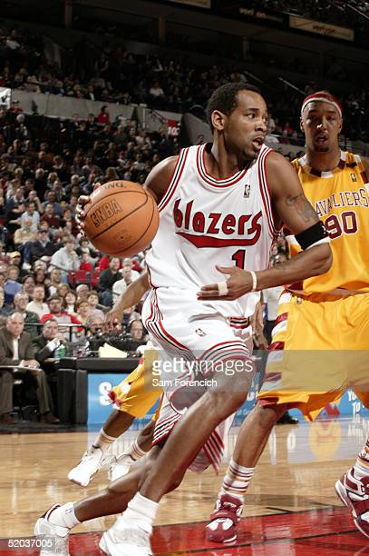 Derek Anderson of the Portland Trail Blazers drives past Drew Gooden of the Cleveland Cavaliers on January 19 2005 at the Rose Garden Arena in...