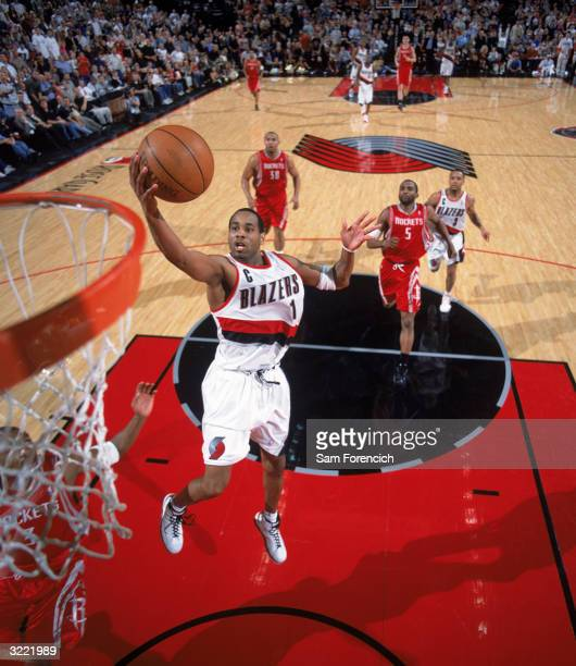 Derek Anderson of the Portland Trail Blazers goes in for a layup during the game against the Houston Rockets at The Rose Garden on March 22 2004 in...