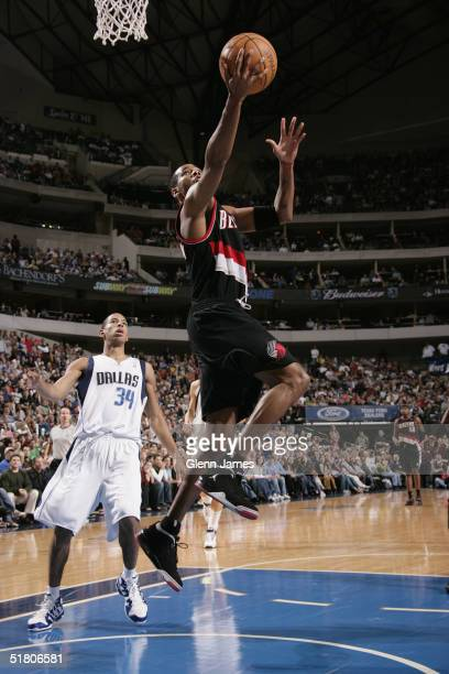 Derek Anderson of the Portland Trails Blazers shoots over Devin Harris of the Dallas Mavericks during the game on November 26 2004 at the American...