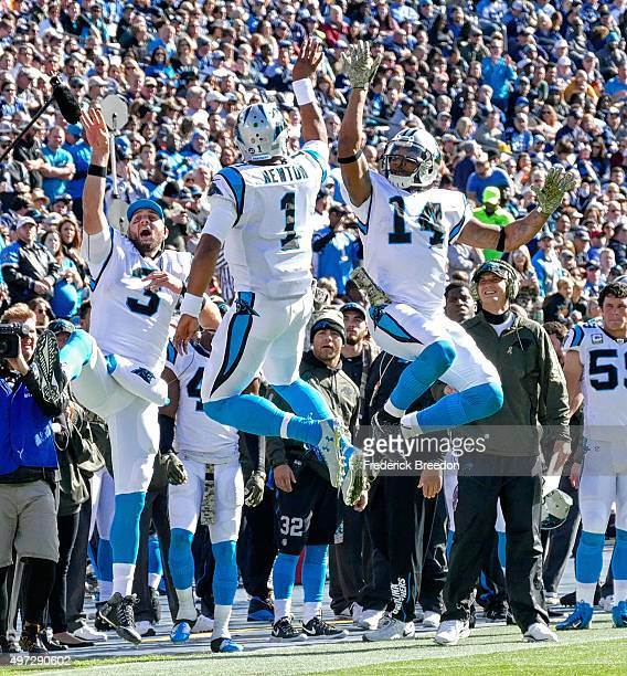 Derek AndersonCam Newton and Joe Webb of the Carolina Panthers celebrate after a touchdown against the Tennessee Titans during the first half at...