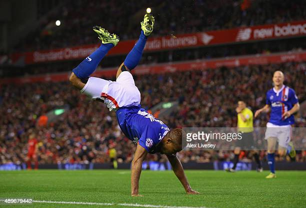 Derek Asamoah of Carlisle United celebrates after scoring his goal during the Capital One Cup Third Round match between Liverpool and Carlisle United...