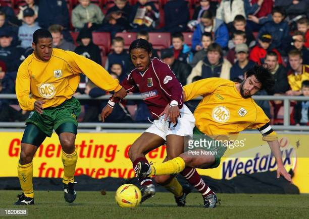 Derek Asamoah of Northampton Town is tackled by Matthew Hill and Tommy Doherty of Bristol City during the Nationwide League Division Two match held...