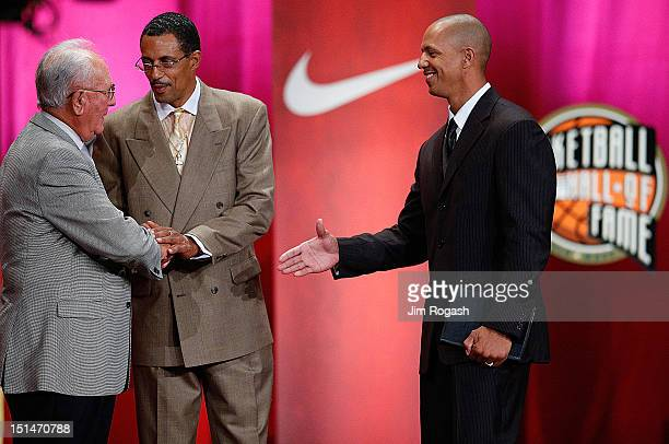 Derek Barksdale shakes hands with presenter Bob Cousy during the induction of Barksdale's father Donald Barksdale during the Basketball Hall of Fame...
