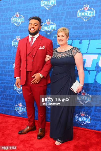 Derek Barnett from Tennessee and his mother Christine on the Red Carpet outside of the NFL Draft Theater on April 27 2017 in Philadelphia PA