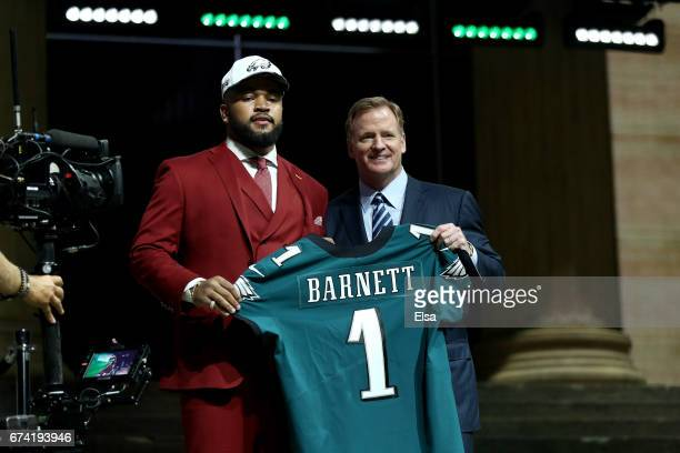 Derek Barnett of Tennessee poses with Commissioner of the National Football League Roger Goodell after being picked overall by the Philadelphia...