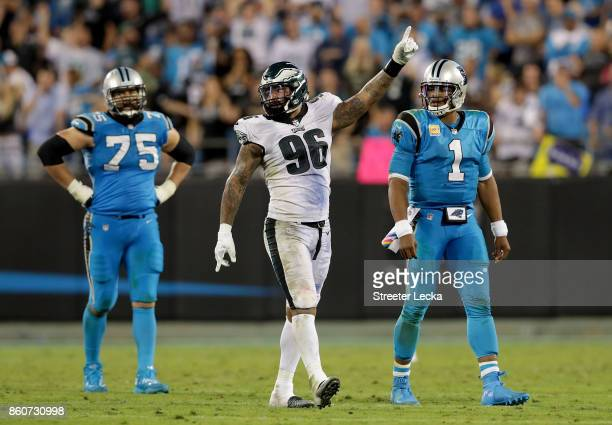 Derek Barnett of the Philadelphia Eagles celebrates after a play as teammates Matt Kalil and Cam Newton of the Carolina Panthers watch on during...