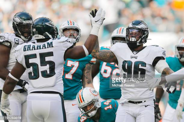 Derek Barnett of the Philadelphia Eagles celebrates with Brandon Graham after a sack against the Miami Dolphins during the first quarter at Hard Rock...