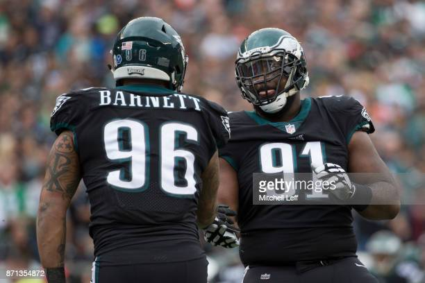 Derek Barnett of the Philadelphia Eagles celebrates with Fletcher Cox against the Denver Broncos at Lincoln Financial Field on November 5 2017 in...