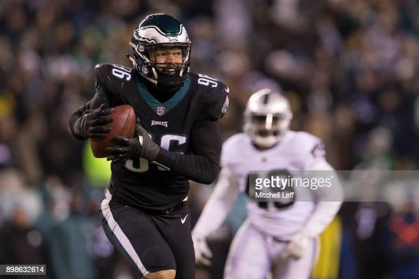 Derek Barnett of the Philadelphia Eagles picks up a fumble and runs past Jamize Olawale of the Oakland Raiders to score a touchdown as time expired...