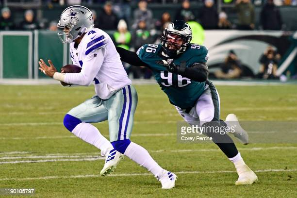 Derek Barnett of the Philadelphia Eagles pressures Dak Prescott of the Dallas Cowboys during the second quarter at Lincoln Financial Field on...