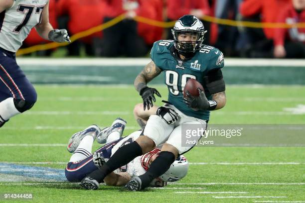 Derek Barnett of the Philadelphia Eagles recovers a fumble by Tom Brady of the New England Patriots during the fourth quarter in Super Bowl LII at...
