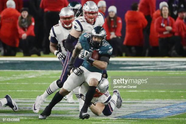 Derek Barnett of the Philadelphia Eagles recovers the ball after teammate Brandon Graham sacked Tom Brady of the New England Patriots in the fourth...