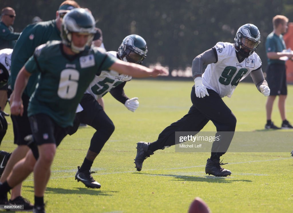 Derek Barnett #96 of the Philadelphia Eagles runs down the field on a kickoff by Caleb Sturgis #6 of the Philadelphia Eagles during mandatory minicamp at the NovaCare Complex on June 13, 2017 in Philadelphia, Pennsylvania.